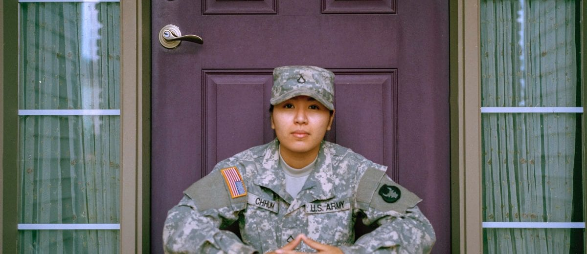 photo of female veteran sitting in front of door